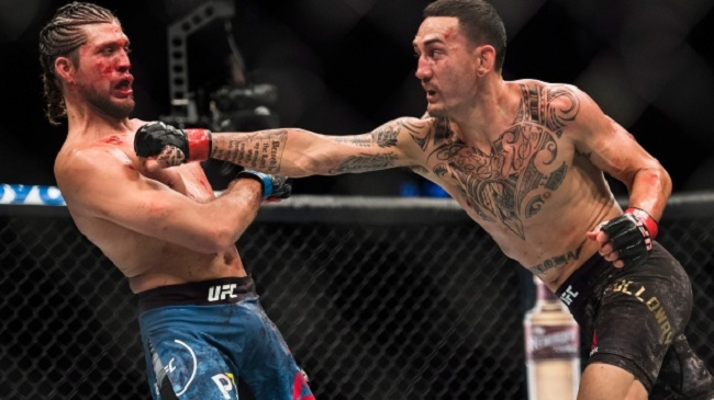 Featherweight champ Max Holloway hammers Brian Ortega e